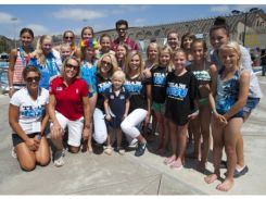 """Joy Splash"" swimmers line up for a photo with U.S. Olympic swimmers, Julie Swail-Ertel (Women's 2000 Waterpolo Captain), of Irvine, Kaitlyn Sandeno (2000, 2004), of Irvine, and Chloe Sutton (2008, 2012), of Mission Viejo.  Photo Courtesy of David Bro, OC Register"
